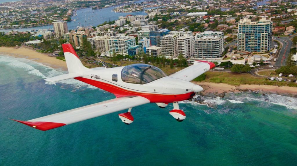 Sling flying over Mooloolaba