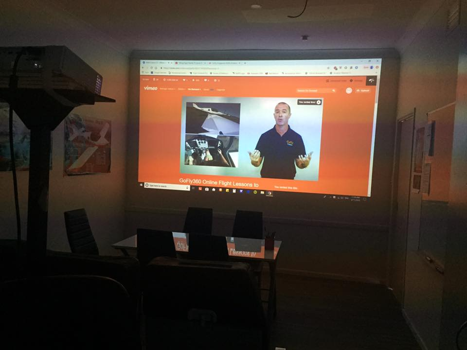 GoFly360 online lessons projected on wall