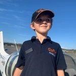 small boy near plane